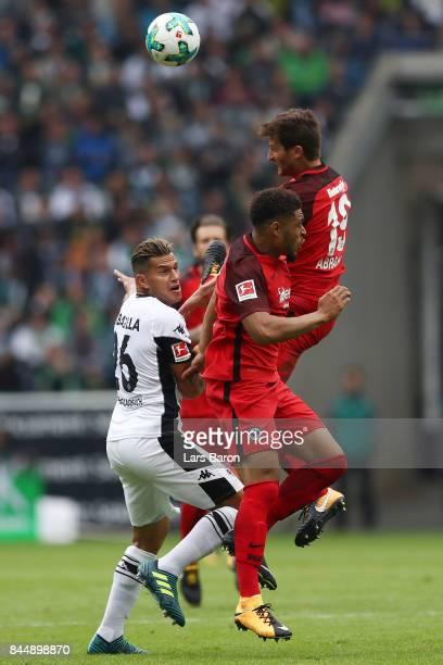 Raul Bobadilla of Moenchengladbach Simon Falette of Frankfurt and David Abraham of Frankfurt fight for the ball during the Bundesliga match between...