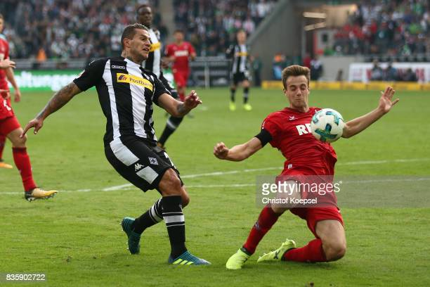 Raul Bobadilla of Moenchengladbach with Lukas Kluenter of Koeln during the Bundesliga match between Borussia Moenchengladbach and 1 FC Koeln at...
