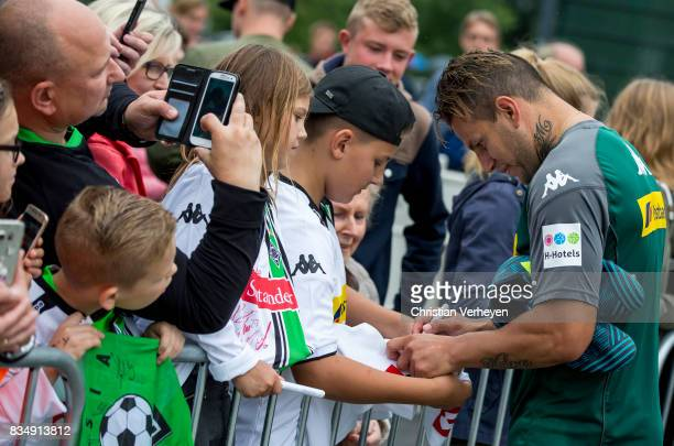 Raul Bobadilla sign for the Supporters during the training session of Borussia Moenchengladbach at BorussiaPark on August 18 2017 in Moenchengladbach...