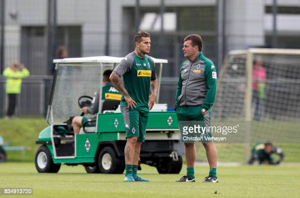 Raul Bobadilla talks to Head Coach Dieter Hecking during the training session of Borussia Moenchengladbach at BorussiaPark on August 18 2017 in...