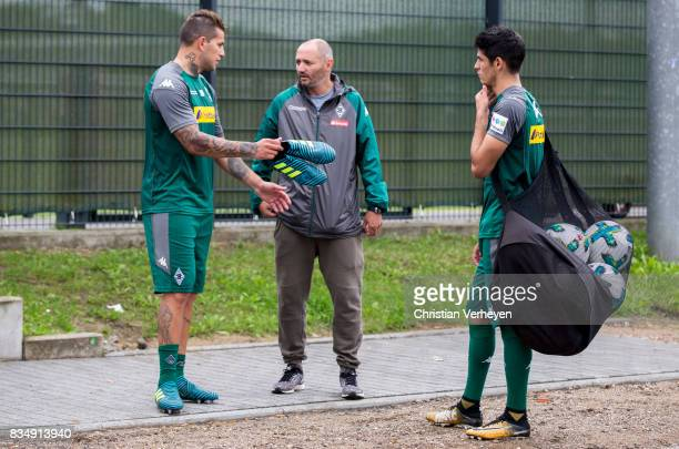 Raul Bobadilla talks to Oliver Neuville and Julio Villalba during the training session of Borussia Moenchengladbach at BorussiaPark on August 18 2017...