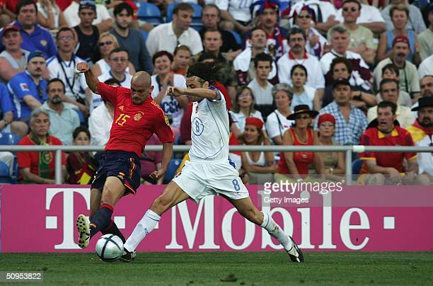 Raul Bravo of Spain battles with Rolan Gusev of Russia during the Spain v Russia Group A match in the 2004 UEFA European Football Championships at...