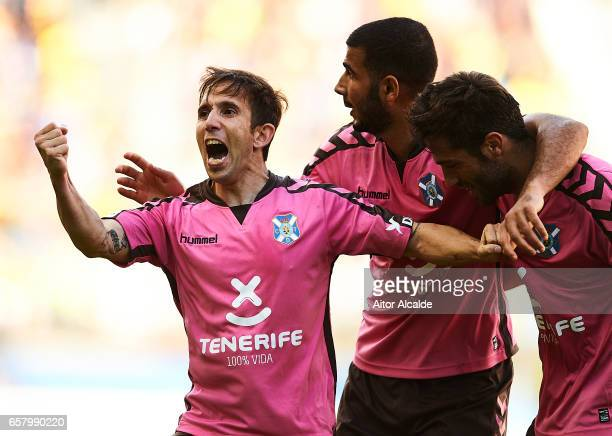Raul Camara of CD Tenerife celebrates with his team mates after scoring his team mate Amath Ndiaye CD Tenerife during La Liga Segunda Division...