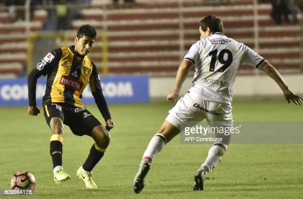 Raul Castro of Bolivia's The Strongest vies for the ball with Nicolás Diego Aguirre of Lanus of Argentina during their Copa Libertadores match at...