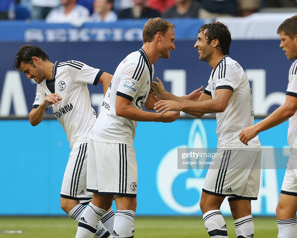 Raul (R) celebrates with Benedikt Hoevedes after scoring during his farewell match between Schalke 04 and Al-Sadd Sports Club Katar at Veltins Arena on July 27, 2013 in Gelsenkirchen, Germany.