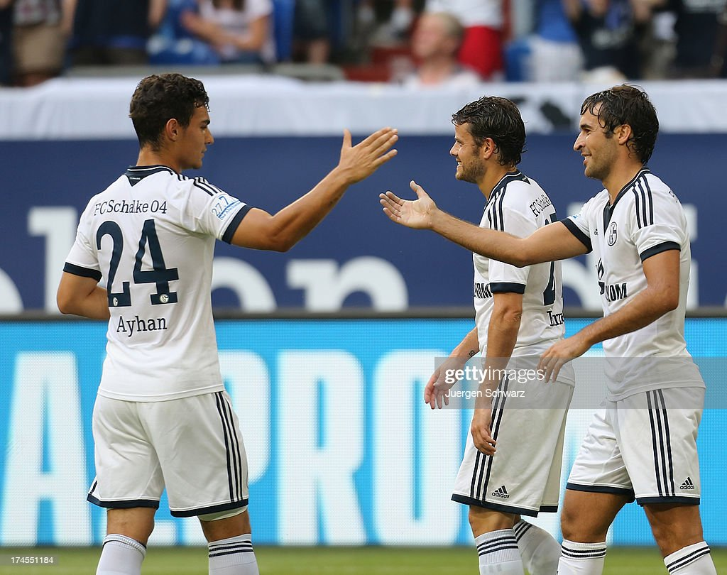 Raul (R) celebrates with Kaan Ayhan (L) after scoring during his farewell match between Schalke 04 and Al-Sadd Sports Club Katar at Veltins Arena on July 27, 2013 in Gelsenkirchen, Germany.