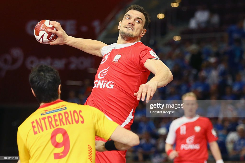 Raul Enterrios of Spain (L) defends against <a gi-track='captionPersonalityLinkClicked' href=/galleries/search?phrase=Michal+Jurecki&family=editorial&specificpeople=4116955 ng-click='$event.stopPropagation()'>Michal Jurecki</a> of Poland (R)during the third place match between Poland and Spain in the Men's Handball World Championship at Lusail Multipurpose Hall on February 1, 2015 in Doha, Qatar.