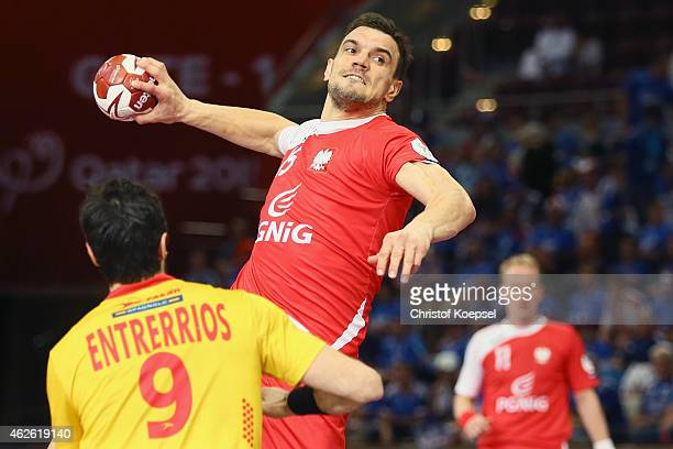 Raul Enterrios of Spain defends against Michal Jurecki of Poland during the third place match between Poland and Spain in the Men's Handball World...