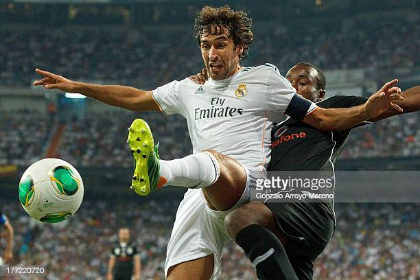 Raul ex player of Real Madrid competes for the ball with Nadir Belhadj of Al Saad during the Santiago Bernabeu Trophy match between Real Madrid CF...