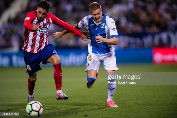 Raul Garcia Carnero of CD Leganes fights for the ball with Jose Maria Gimenez de Vargas of Atletico de Madrid during the La Liga 201718 match between...