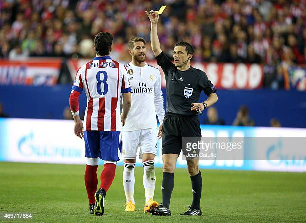 Raul Garcia Escudero of Atletico Madrid is shown a yellow card by referee Milorad Mazic of Serbia during the UEFA Champions League Quarter Final...