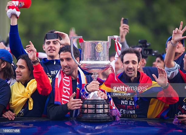 Raul Garcia Jand uan Francisco 'Juanfran' of Atletico de Madrid celebrate with the trophy from an opentop bus a day after winning the Copa del Rey...