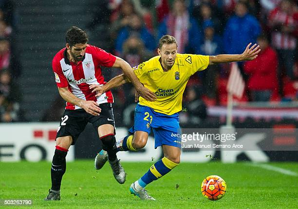 Raul Garcia of Athletic Club duels for the ball with Dani Castellano of UD Las Plamas during the La Liga match between Athletic Club and UD Las...