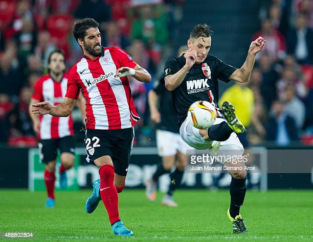 Raul Garcia of Athletic Club duels for the ball with Dominik Kohr of FC Augsburg during the UEFA Europa League match between Athletic Club and FC...