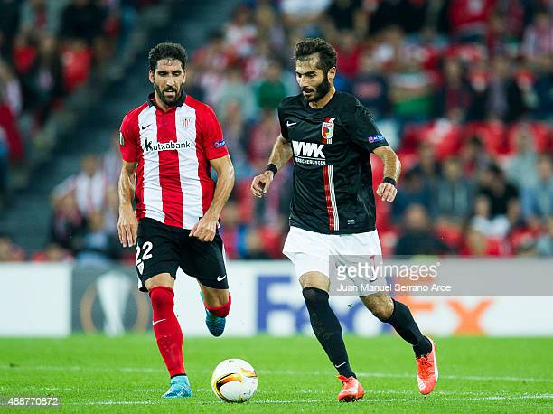 Raul Garcia of Athletic Club duels for the ball with Halil Altontop of FC Augsburg during the UEFA Europa League match between Athletic Club and FC...