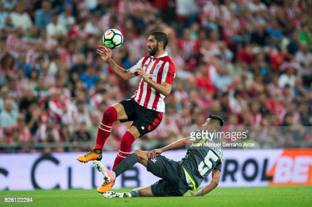 Raul Garcia of Athletic Club duels for the ball with Ionut Nedelcearu of Dinamo Bucarest during the UEFA Europa League Third Qualifying Round Second...
