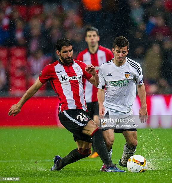 Raul Garcia of Athletic Club duels for the ball with Jose Gaya of Valencia CF during the UEFA Europa League Round of 16 First Leg match between...