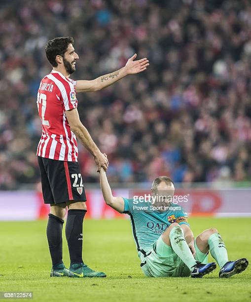Raul Garcia of Athletic Club reacts as he helps Andres Iniesta Lujan of FC Barcelona after referee David Fernandez Borbalan shows him the yellow card...