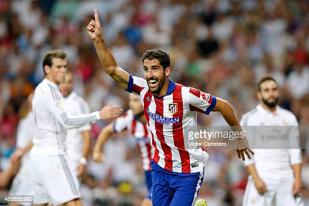 Raul Garcia of Atletico de Madrid celebrates after scoring during the Supercopa first leg match between Real Madrid and Atletico de Madrid at Estadio...