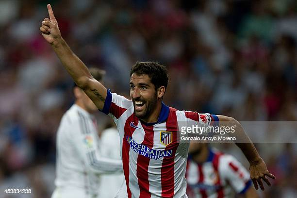 Raul Garcia of Atletico de Madrid celebrates scoring their opening goal during the Supercopa first leg match between Real Madrid and Club Atletico de...