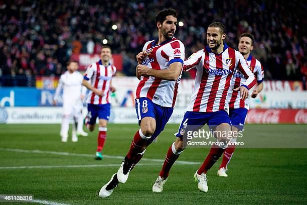 Raul Garcia of Atletico de Madrid celebrates scoring their opening goal with his teammate Mario Suarez during the Copa del Rey Round of 16 first leg...