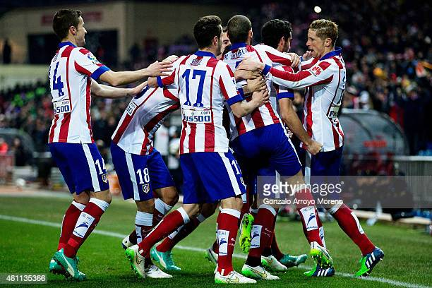 Raul Garcia of Atletico de Madrid celebrates scoring their opening goal with teammates as Fernando Torres during the Copa del Rey Round of 16 first...