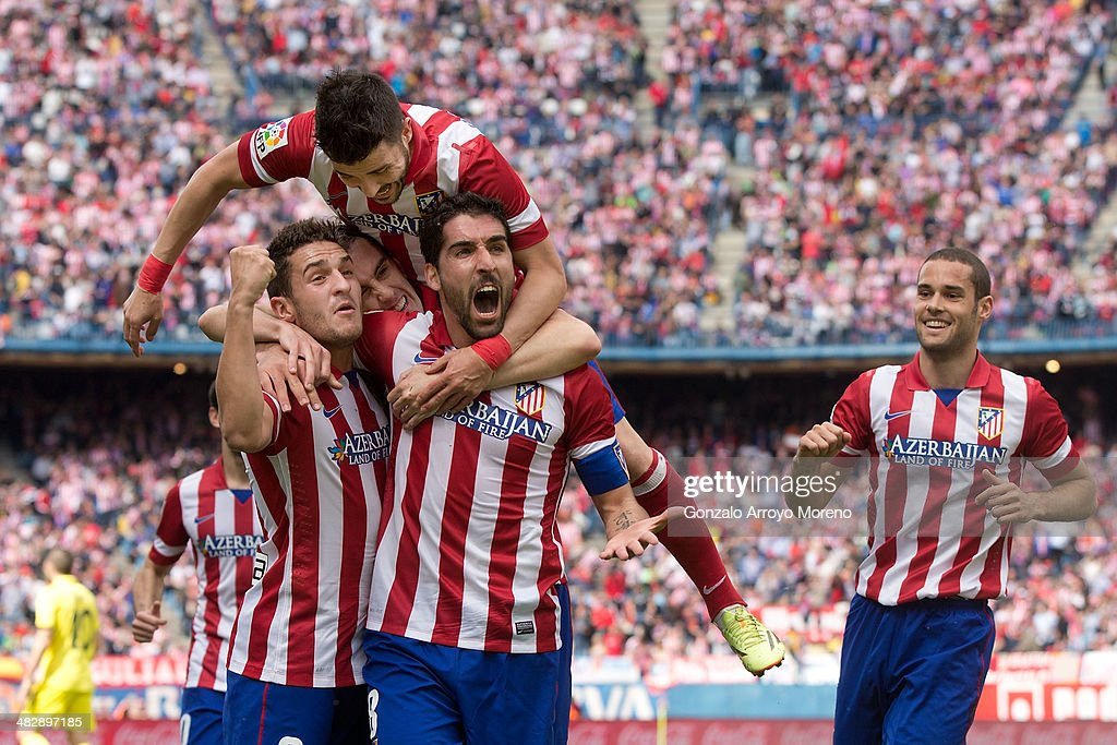 Raul Garcia (2ndR) of Atletico de Madrid celebrates scoring their opening goal with team-mates Koke (L), <a gi-track='captionPersonalityLinkClicked' href=/galleries/search?phrase=Diego+Godin&family=editorial&specificpeople=608999 ng-click='$event.stopPropagation()'>Diego Godin</a> (2ndL)<a gi-track='captionPersonalityLinkClicked' href=/galleries/search?phrase=David+Villa&family=editorial&specificpeople=467566 ng-click='$event.stopPropagation()'>David Villa</a> (3dL) and Mario Suarez (R) during the La Liga match between Club Atletico de Madrid and Villarreal CF at Vicente Calderon Stadium on April 5, 2014 in Madrid, Spain.