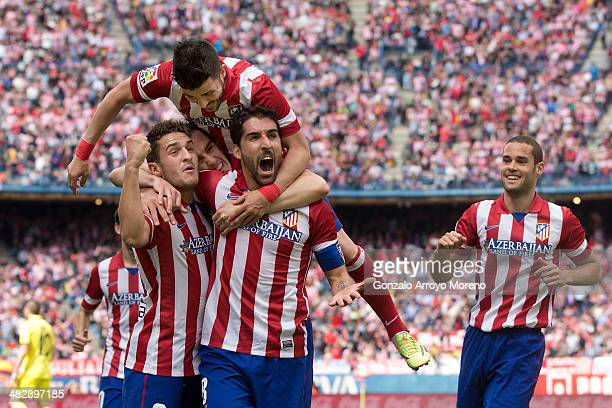 Raul Garcia of Atletico de Madrid celebrates scoring their opening goal with teammates Koke Diego Godin David Villa and Mario Suarez during the La...