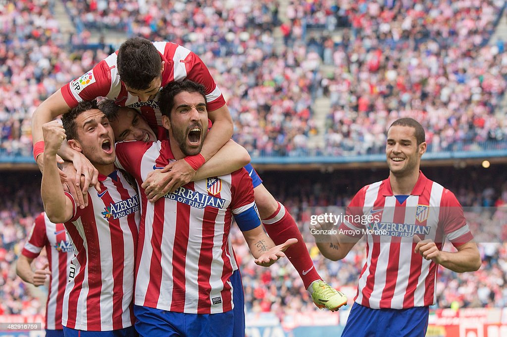 Raul Garcia (2ndR) of Atletico de Madrid celebrates scoring their opening goal with teammates Koke (L), <a gi-track='captionPersonalityLinkClicked' href=/galleries/search?phrase=Diego+Godin&family=editorial&specificpeople=608999 ng-click='$event.stopPropagation()'>Diego Godin</a> (2ndL)<a gi-track='captionPersonalityLinkClicked' href=/galleries/search?phrase=David+Villa&family=editorial&specificpeople=467566 ng-click='$event.stopPropagation()'>David Villa</a> (3dL) and Mario Suarez (R) during the La Liga match between Club Atletico de Madrid and Villarreal CF at Vicente Calderon Stadium on April 5, 2014 in Madrid, Spain.