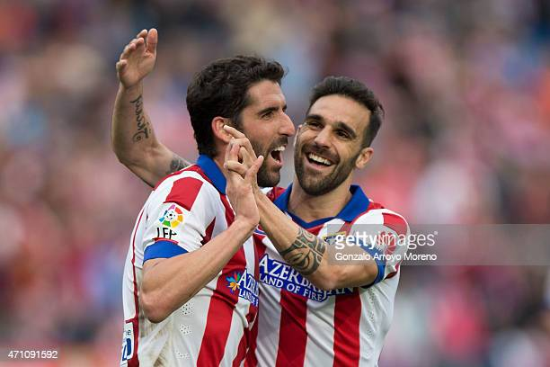 Raul Garcia of Atletico de Madrid celebrates scoring their second goal with teammate Jesus Gamez during the La Liga match between Club Atletico de...