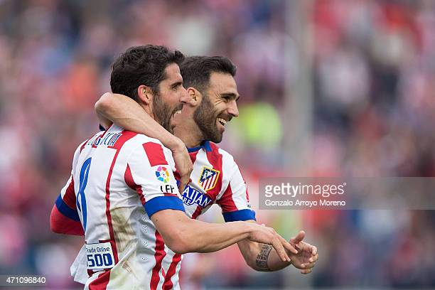 Raul Garcia of Atletico de Madrid celebrates scoring their second goal with team mate Jesus Gamez during the La Liga match between Club Atletico de...