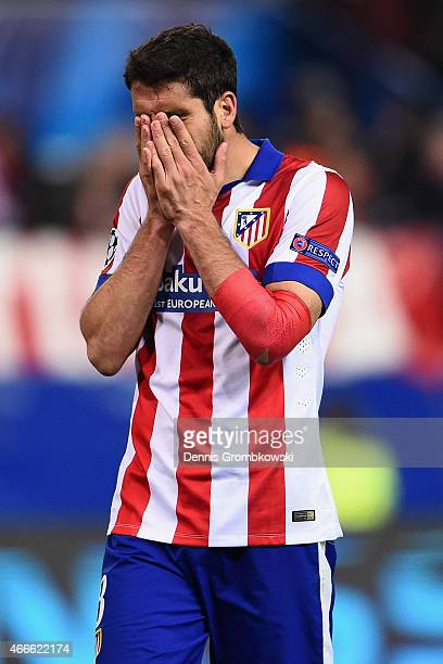 Raul Garcia of Atletico Madrid reacts after missing a penalty in the shoot out during the UEFA Champions League round of 16 match between Club...