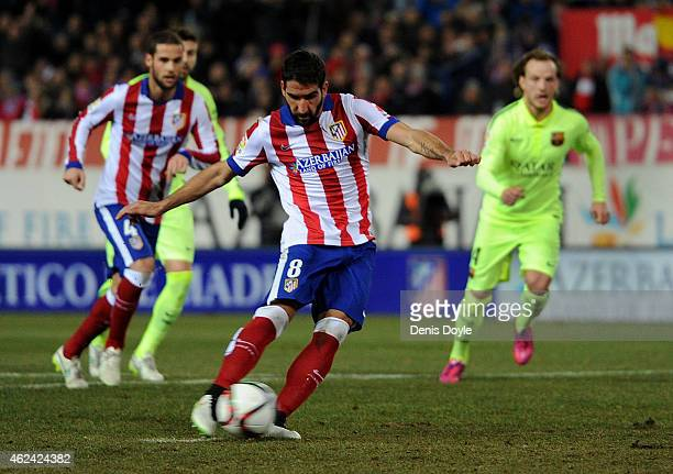 Raul Garcia of Club Atletico de Madrid scores his team's 2nd goal from the penalty spot during the Copa del Rey Quarter Final Second Leg match...