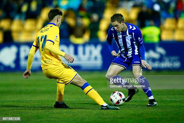 Raul Garcia of Deportivo Alaves competes for the ball with Ivan Alejo of Agrupacion Deportivo Alcorcon during the Copa del Rey quarterfinal match...