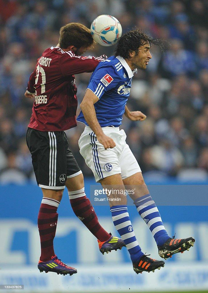 Raul Gonzales of Schalke is challenged by Marvin Plattenhardt of Nuernberg during the Bundesliga match between FC Schalke 04 and 1 FC Nuernberg at...