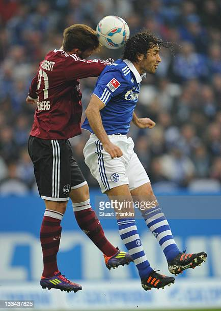 Raul Gonzales of Schalke is challenged by Marvin Plattenhardt of Nuernberg during the Bundesliga match between FC Schalke 04 and 1 FC Nuernberg at...