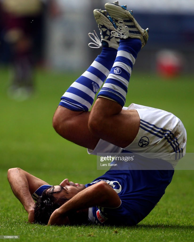 Raul Gonzales of Schalke lies dejected on the pitch during the Bundesliga match between FC Schalke 04 and Hannover 96 at Veltins Arena on August 28...