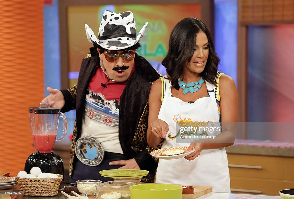 Raul Gonzalez and <a gi-track='captionPersonalityLinkClicked' href=/galleries/search?phrase=Karla+Martinez&family=editorial&specificpeople=732238 ng-click='$event.stopPropagation()'>Karla Martinez</a> during Univision's 'Despierta America' at Univision Headquarters on September 4, 2013 in Miami, Florida.