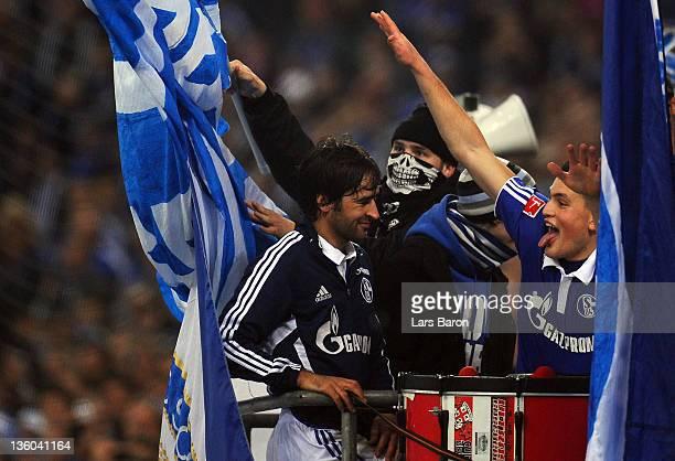 Raul Gonzalez and Kyriakos Papadopoulos of Schalke celebrate with the fans after winning the Bundesliga match between FC Schalke 04 and SV Werder...
