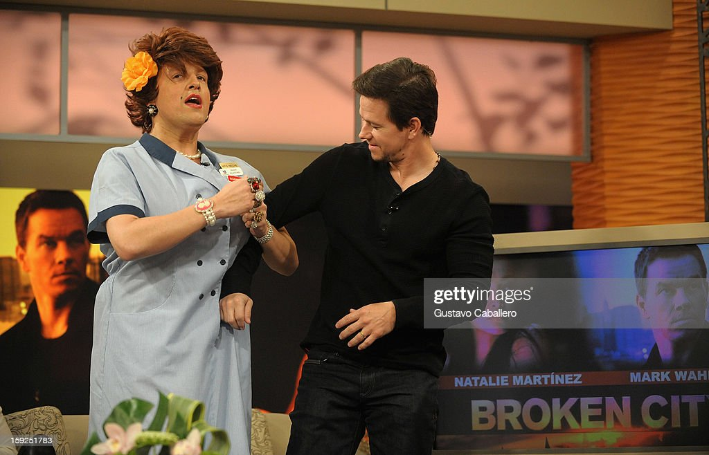 Raul Gonzalez and <a gi-track='captionPersonalityLinkClicked' href=/galleries/search?phrase=Mark+Wahlberg&family=editorial&specificpeople=202265 ng-click='$event.stopPropagation()'>Mark Wahlberg</a> on The Set Of Despierta America to promote new film 'Broken City' at Univision Headquarters on January 10, 2013 in Miami, Florida.
