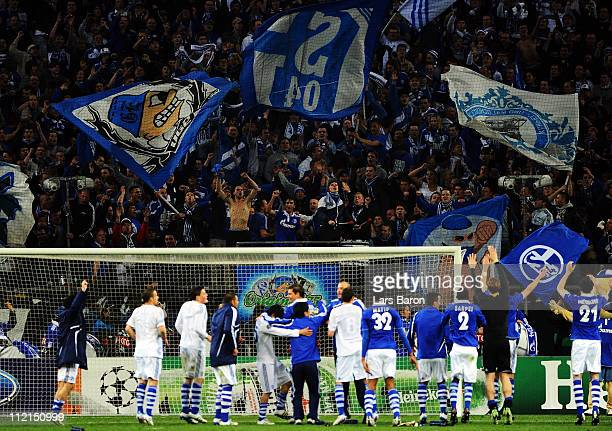 Raul Gonzalez celebrates with the fans and his team mates after winning the UEFA Champions League quarter final second leg match against Inter Milan...