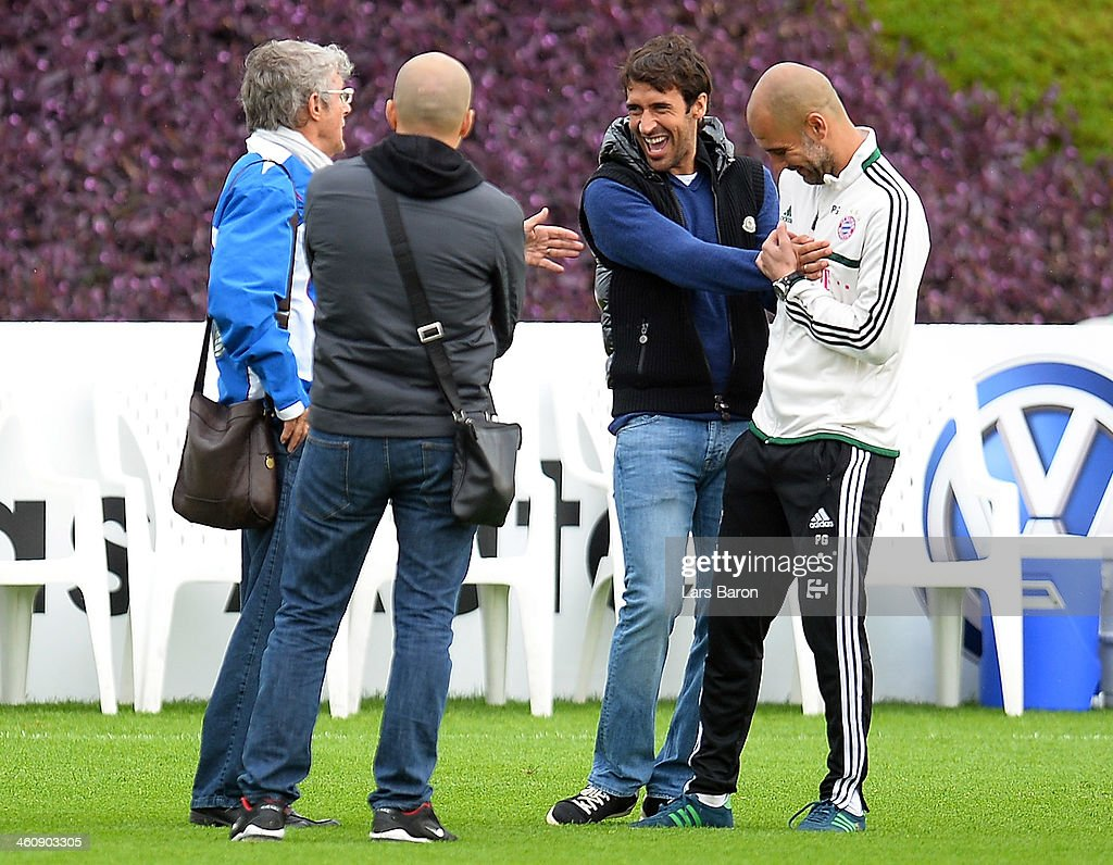Raul Gonzalez former player of Real Madrid hughs head coach Josep Guardiola during a training session at day 2 of the Bayern Muenchen training camp...