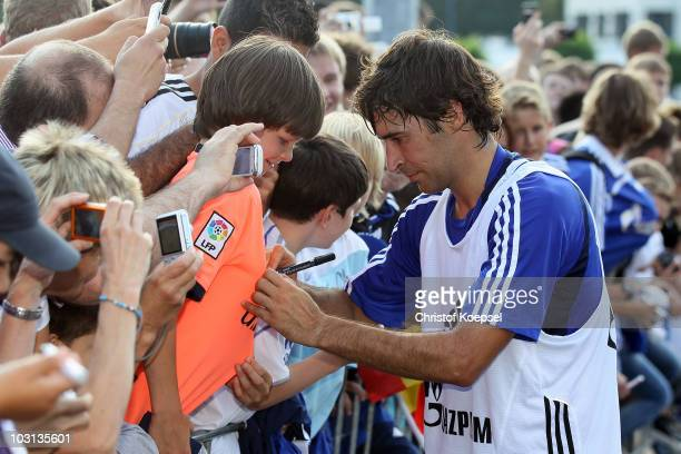 Raul Gonzalez gives autographs during the FC Schalke training session at the training ground on July 28 2010 in Gelsenkirchen Germany