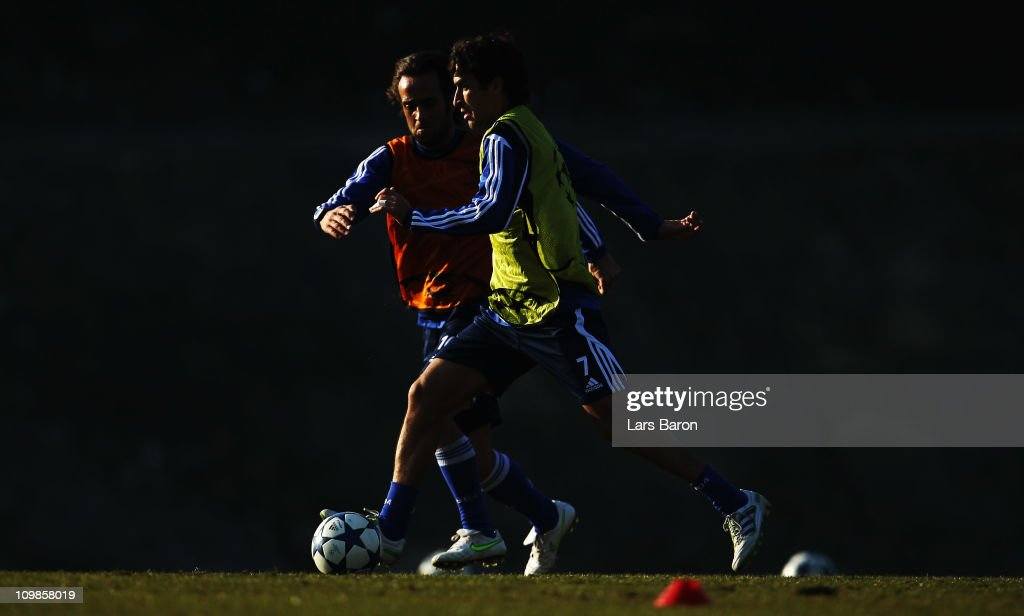 Raul Gonzalez is challenged by Ali Karimi during a FC Schalke 04 training session ahead of the UEFA Champions League Round of 16 second leg match...