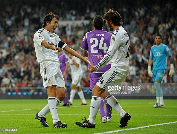Raul Gonzalez of Real Madrid celebrates scoring his sides opening goal with his teammate Esteban Granero during the La Liga match between Real Madrid...