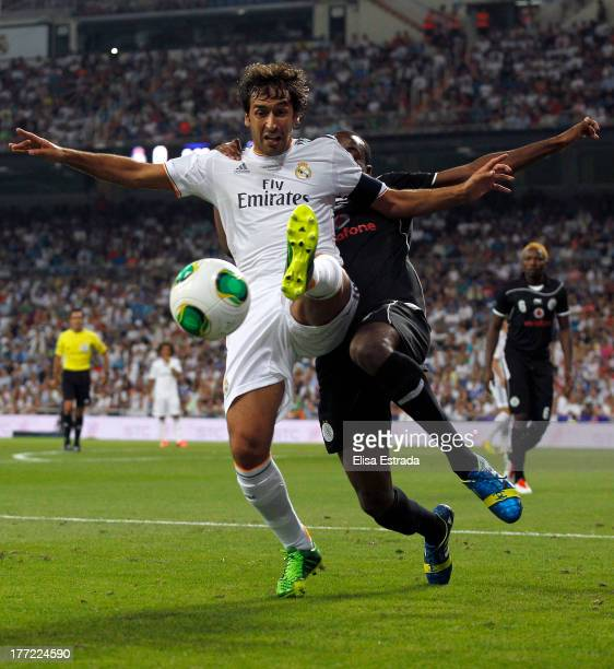 Raul Gonzalez of Real Madrid competes for the ball with Nadir Belhadj of Al Saad during the Santiago Bernabeu Trophy match between Real Madrid CF and...