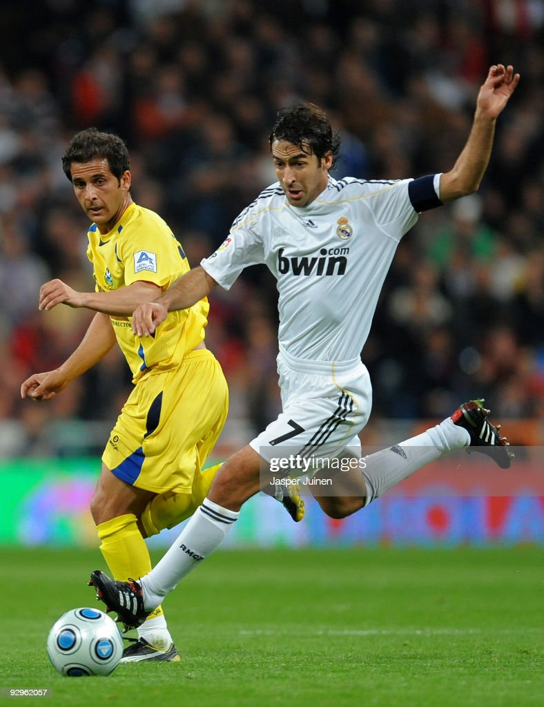 Raul Gonzalez of Real Madrid duels for the ball with Sergio Mora of AD Alcorcon during the Copa del Rey fourth round second leg match between Real...