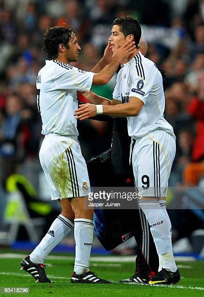 Raul Gonzalez of Real Madrid embraces his team mate Cristiano Ronaldo as he is substituted during the Champions League group C match between Real...