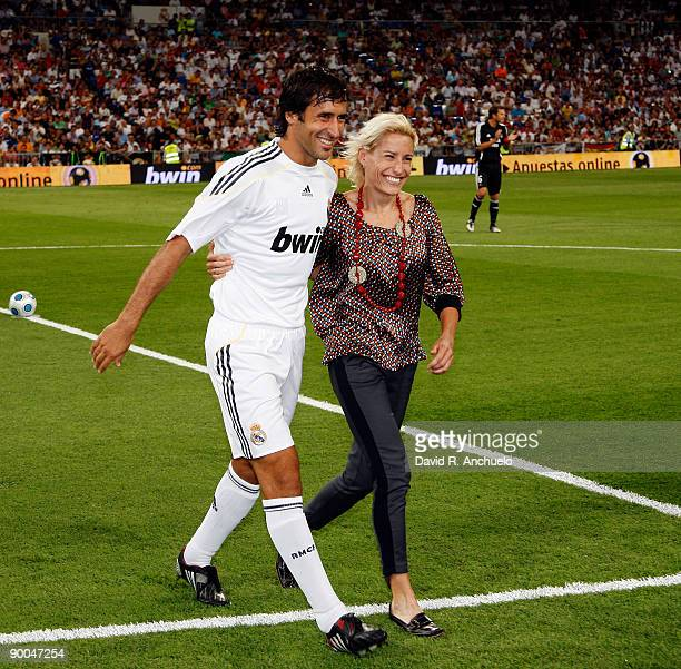 Raul Gonzalez of Real Madrid greets spanish runner Marta Dominguez before the Santiago Bernabeu Trophy match at Estadio Santiago Bernabeu stadium on...