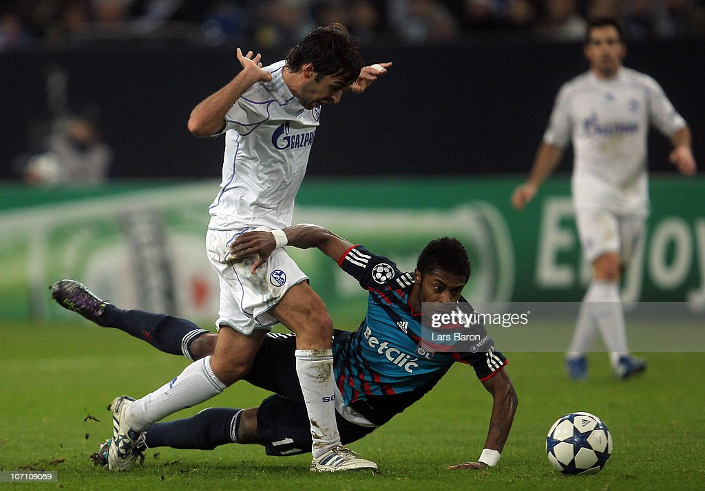 <a gi-track='captionPersonalityLinkClicked' href=/galleries/search?phrase=Raul+Gonzalez+-+Soccer+Player&family=editorial&specificpeople=213309 ng-click='$event.stopPropagation()'>Raul Gonzalez</a> of Schalke challenges <a gi-track='captionPersonalityLinkClicked' href=/galleries/search?phrase=Michel+Bastos&family=editorial&specificpeople=1549621 ng-click='$event.stopPropagation()'>Michel Bastos</a> of Lyonnais during the UEFA Champions League group B match between FC Schalke 04 and Olympique Lyonnais at Veltins Arena on November 24, 2010 in Gelsenkirchen, Germany.